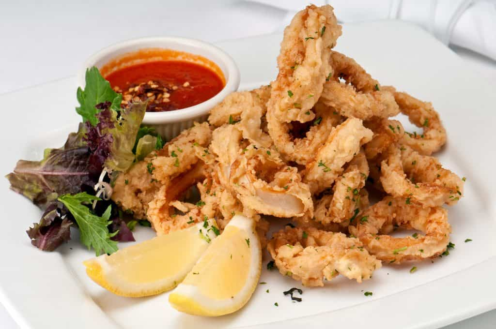 Photo of a white plate serving calamari.