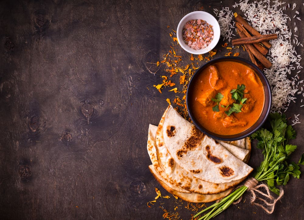 Indian curry with bread, parsley, and cinnamon restaurants in Naples