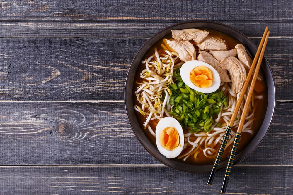 bowl of ramen with pork, eggs, bean sprouts, green onion, and noodles restaurants in Naples