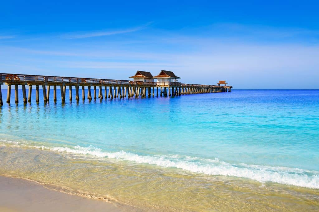 The clear, turquoise waters of the Gulf wash up on the shores of the Naples Municipal Beach & Pier.