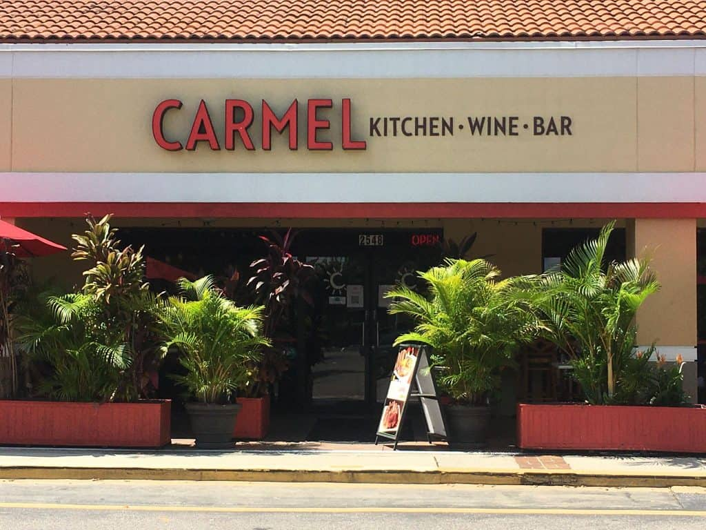 Lush plants surround the patio at Carmel, one of the best restaurants in Clearwater, Florida.