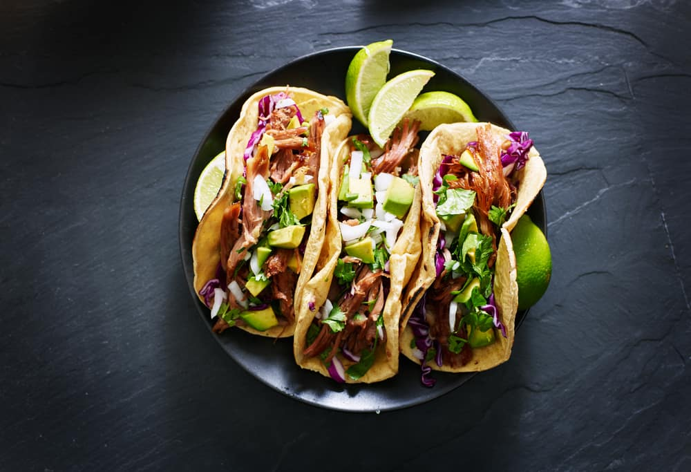 Delicious tacos being served at a mexican style restaurant