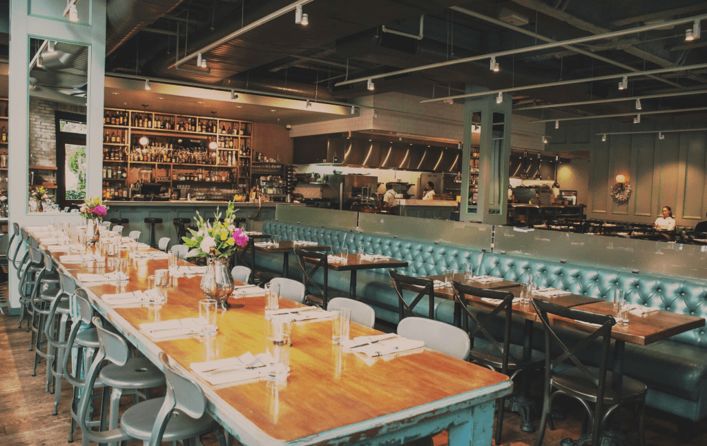 The industrial chic farm tables inside On Swann, Chris Ponte's second restaurant in Tampa.