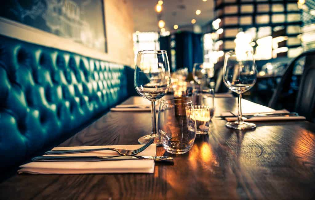 A table at a fine-dining restaurant is set and ready for diners.