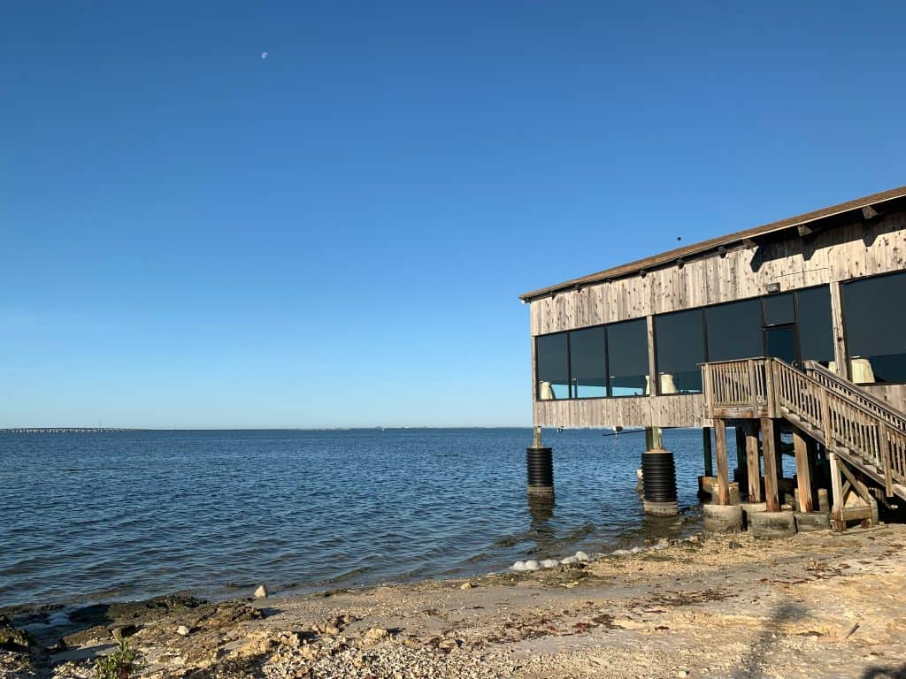 The dining room of Whiskey Joe's jutting out into the Hillsborough Bay.