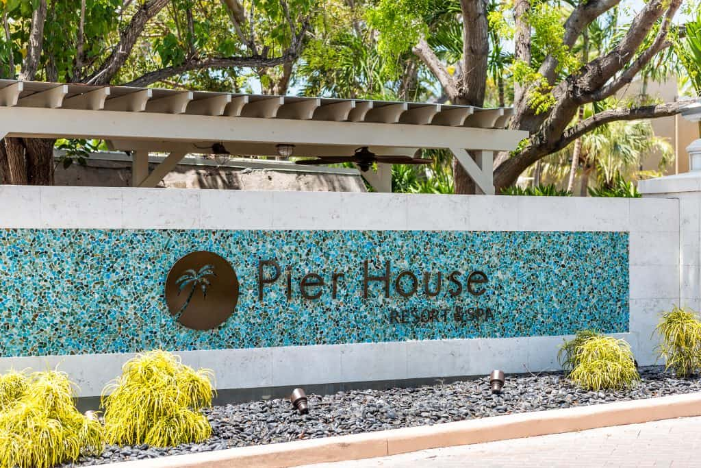 The blue and white glass-tiled sign welcoming guests to the Pier House