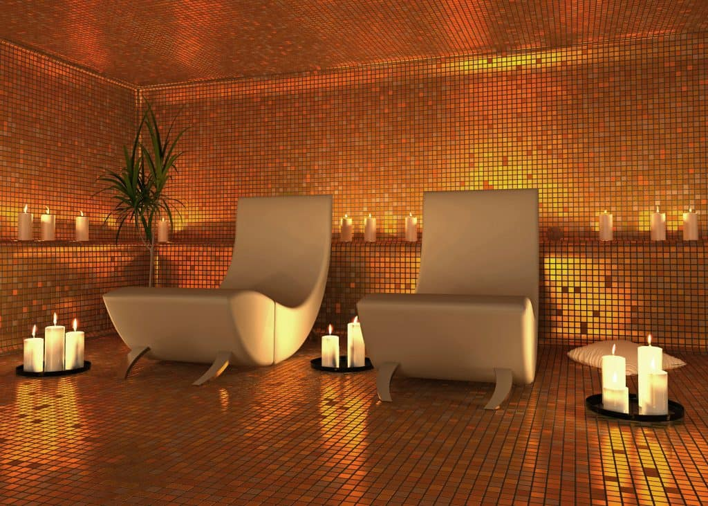 Two lounge chairs surrounded by relaxing candles in a relaxation room.