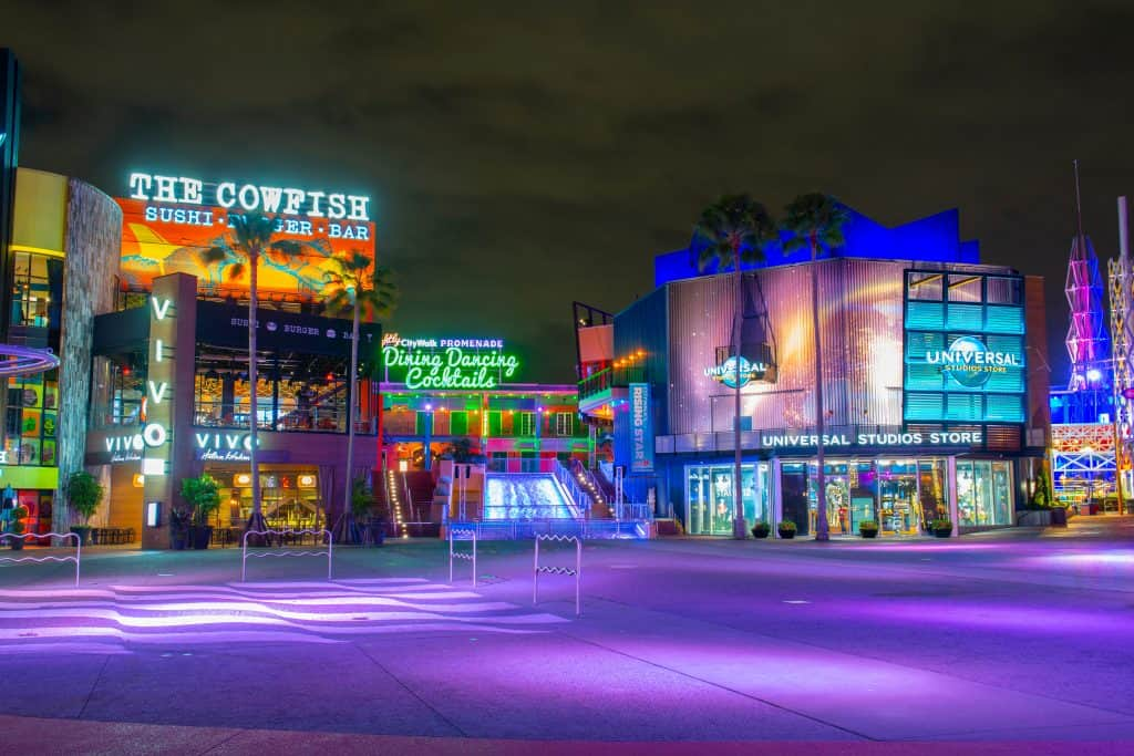 The shops and signage at CityWalk, lit up in the evening.