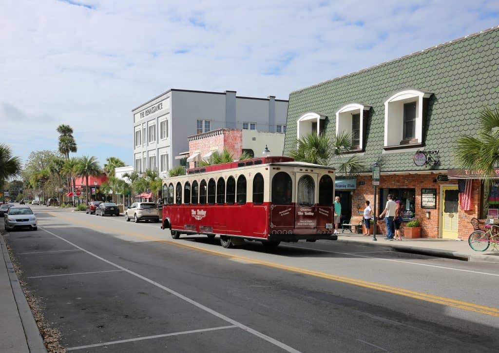 A streetcar cruises downtown in Mount Dora, one of the best places to have a date night in Orlando.
