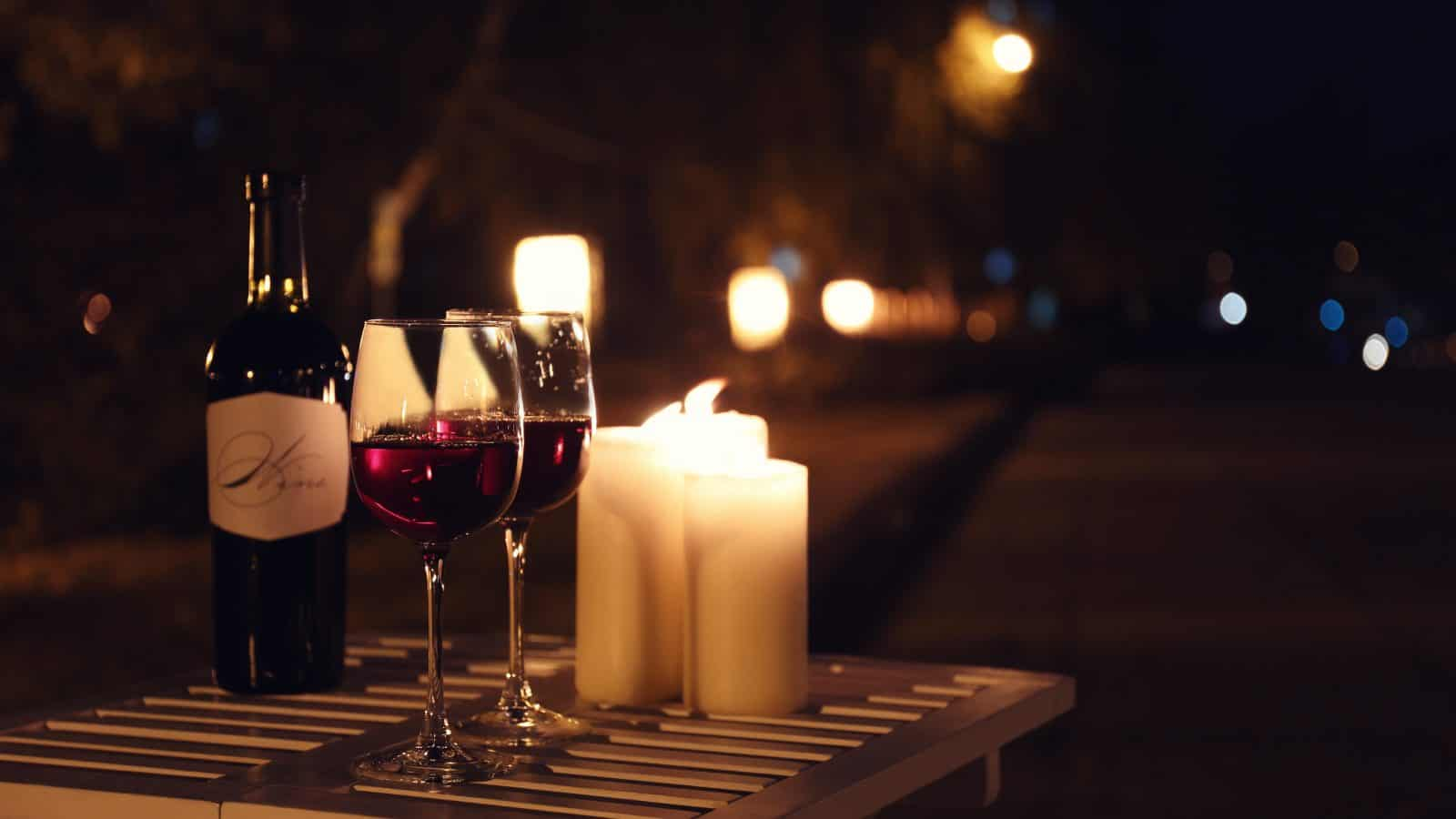 Romantic candles and wine lay the foundation for a perfect date night in Orlando.