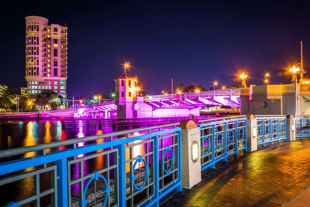 The Tampa Riverwalk, romantically lit for couples during Fourth Friday, a perfect date night in Tampa.