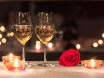 White wine and roses on a date night.