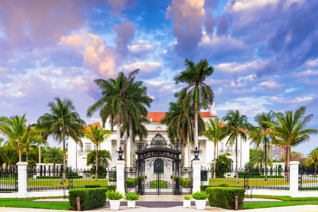 The gates and courtyard of Whitehall Mansion, now the Flagler Museum in Palm Beach, Florida.