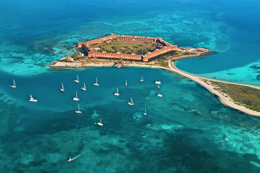 Aerial view of Fort Jefferson and surrounding waters of the Dry Tortugas National Park, where you can encounter wild sea turtles in the Florida Keys.