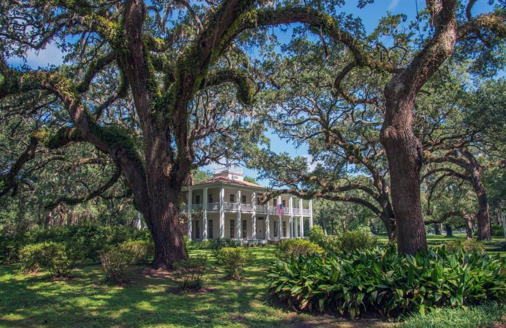 The Wesley Mansion stands under towering oak trees at Eden Gardens State Park, one of the best northern Florida State Parks.