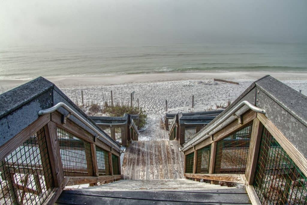 A dock leads guests down to the shores of Grayton Beach State Park.