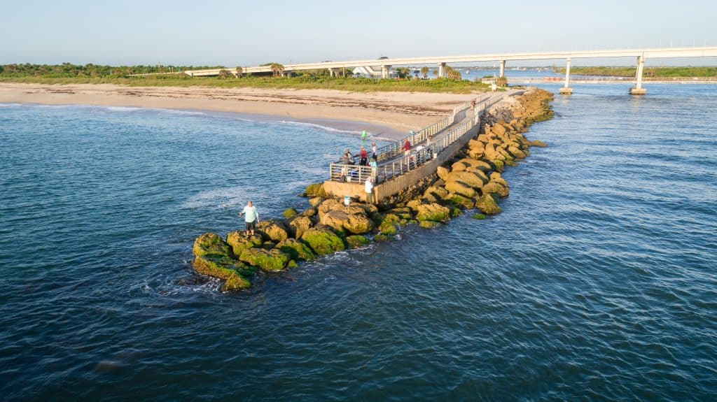 Fishermen cast their lines off the jetty at Sebastian Inlet State Park.