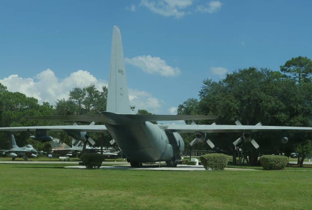 A battle plane sits on the fields at the Air Force Armament Museum.