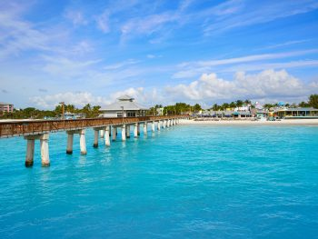 The Fort Myers Pier sits over clear turquoise waters.