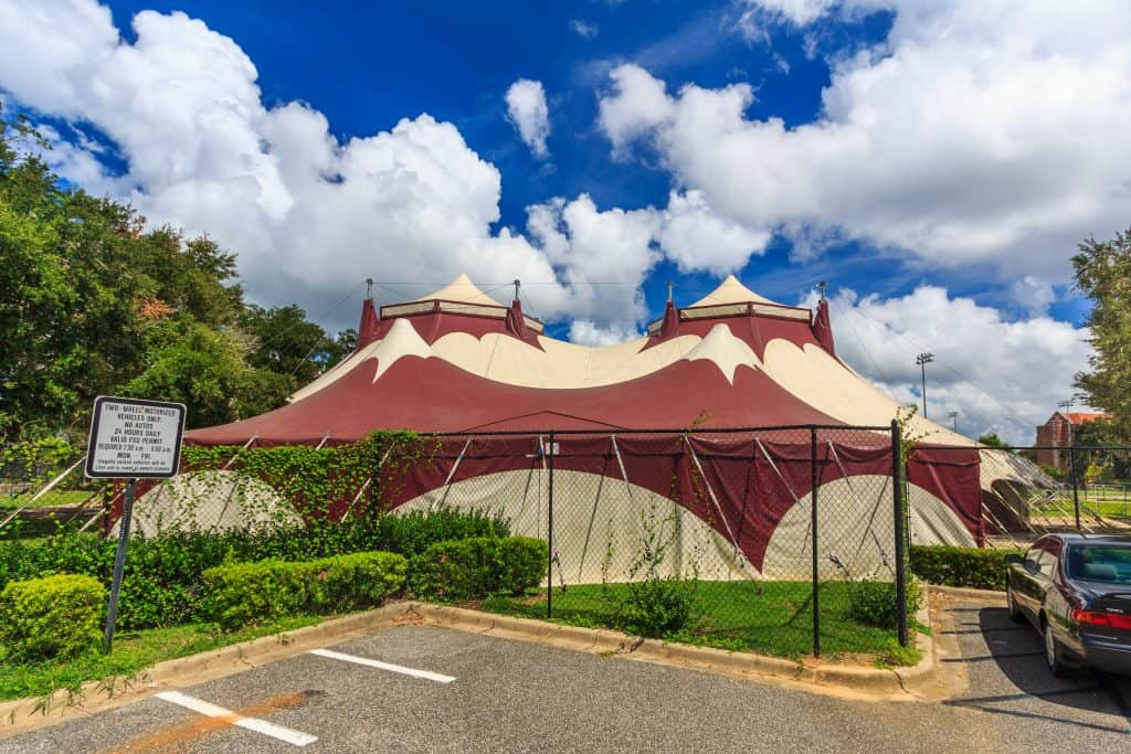 The garnet and gold circus tent stands at the Jack Haskin Circus Complex at Florida State University, one of the best things to do in Tallahassee with kids!