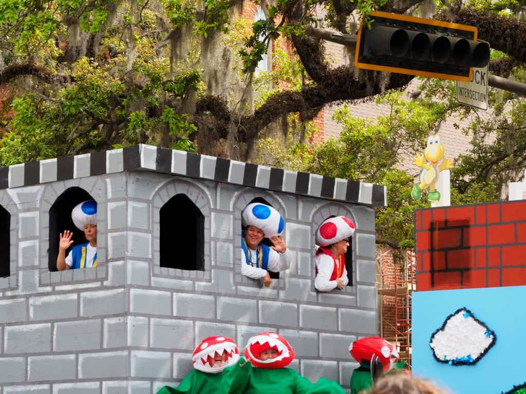 Toads peer out the windows of the castle of Mushroom Kingdom on a festive Mario float during the Springtime Tallahassee Festival!
