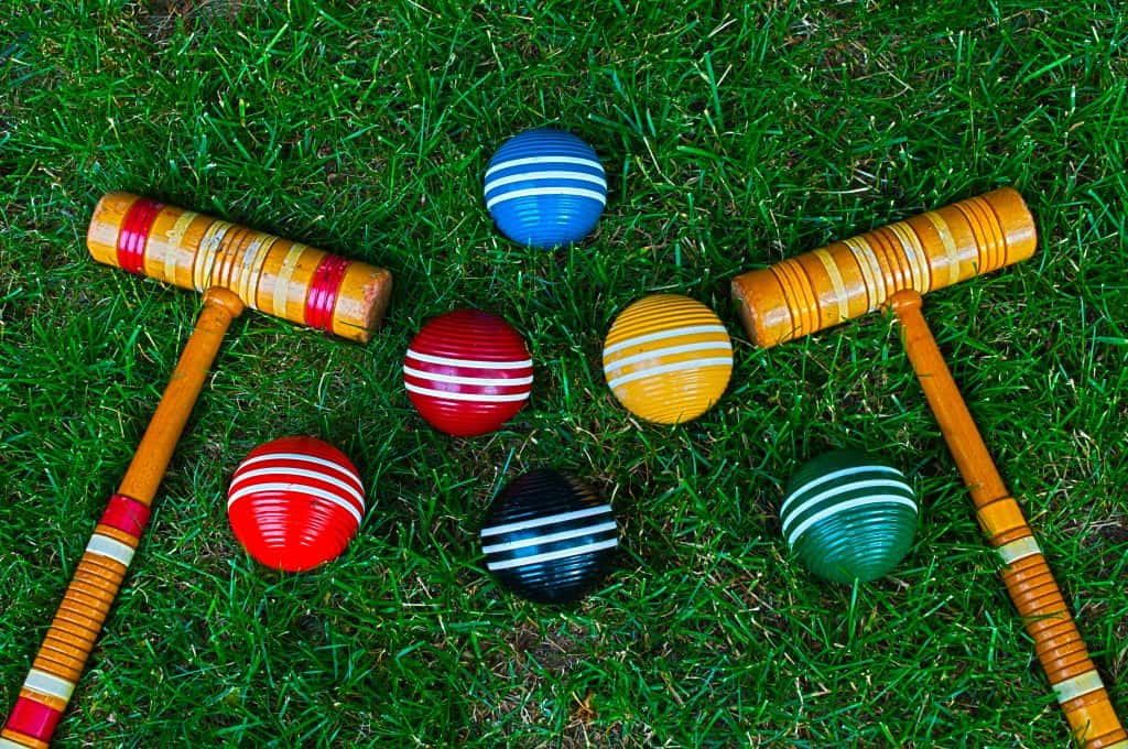 Croquet mallets and balls on a perfectly manicured lawn at the National Croquet Center in West Palm Beach, Florida.