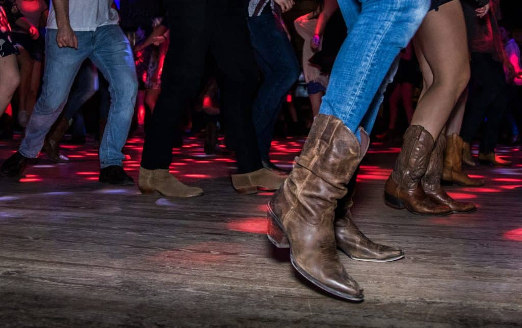 Photo of people country line dancing.