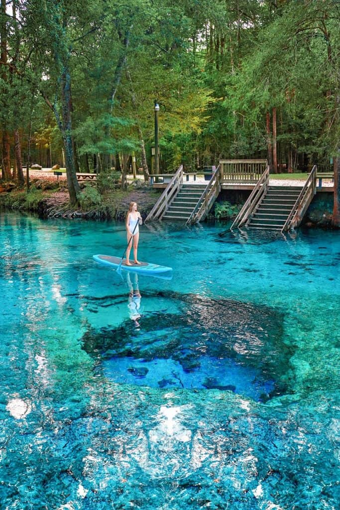stand up paddle boarding over the Devils Eye at Ginnie Springs | prettiest springs in Florida | best things to do in Florida | Ginnie Springs Florida