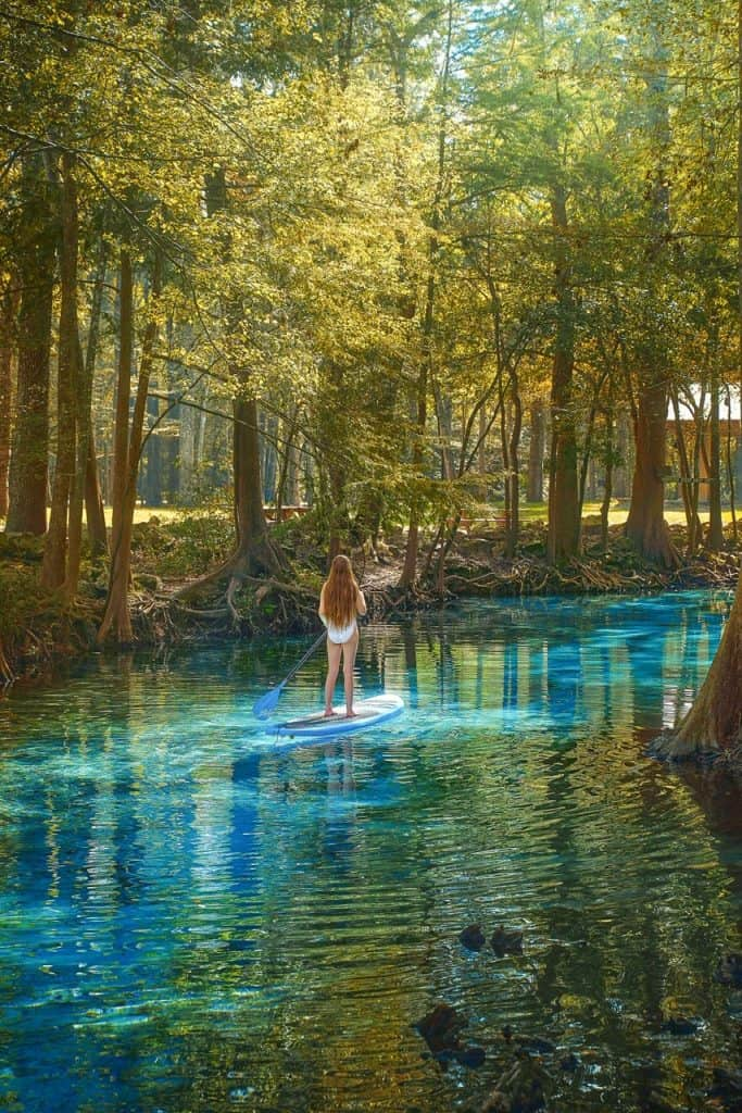 Stand up paddle boarding at Ginnie Springs during sunset | sunset at Ginnie Springs | best Florida springs