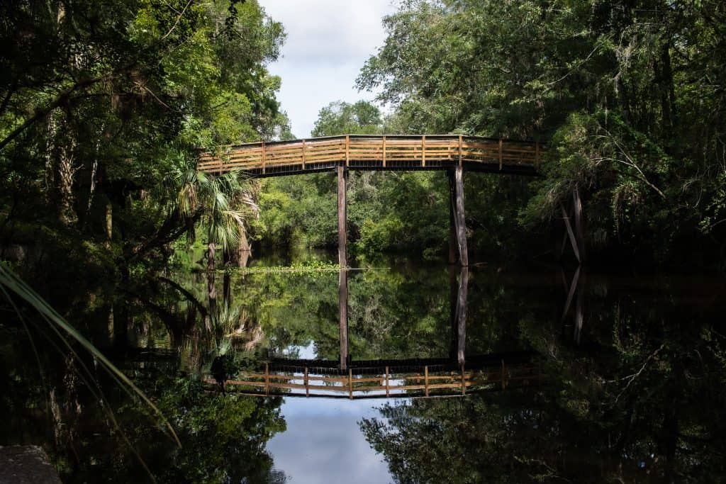 Photo of a wooden bridge going over the Hillsborough River.