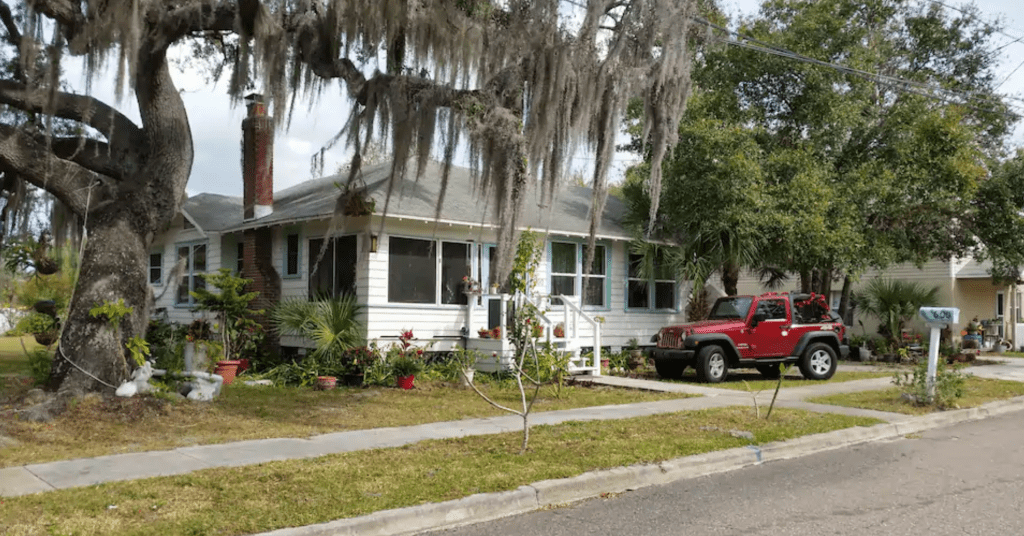 The beautiful Airbnb home draped in Spanish Moss hanging from the Oak trees.