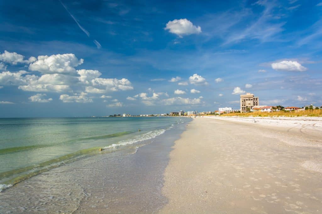 Gentle waves lap at the shores of St. Pete Beach, one of the best beaches in Clearwater and St. Petersburg Florida.