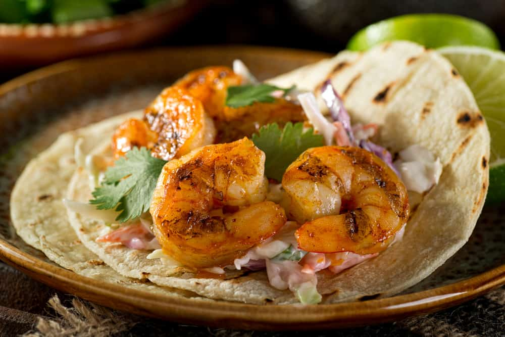 Try the shrimp tacos at Cabo Island Bar and Grill that serves up Mexican food and seafood