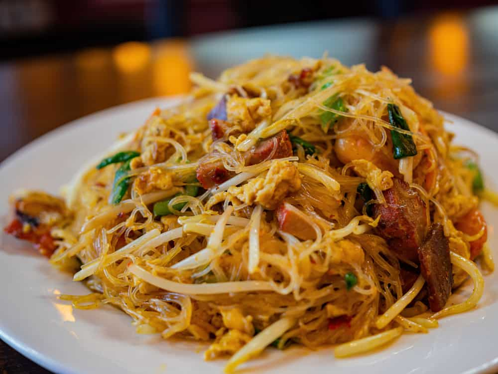 Try the Singapore Noodles at Lucy Ho's restaurant in midtown Tallahassee called Masa