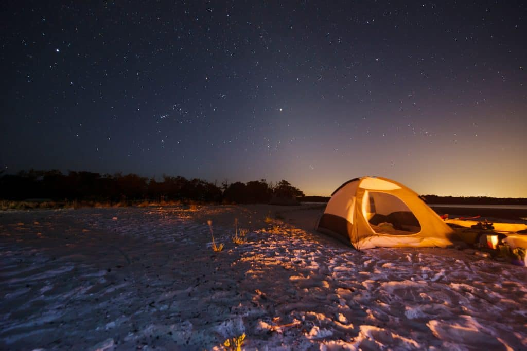 A tent sits on the beaches of the Ten Thousand Islands, one of the few places for true beach camping in Florida.