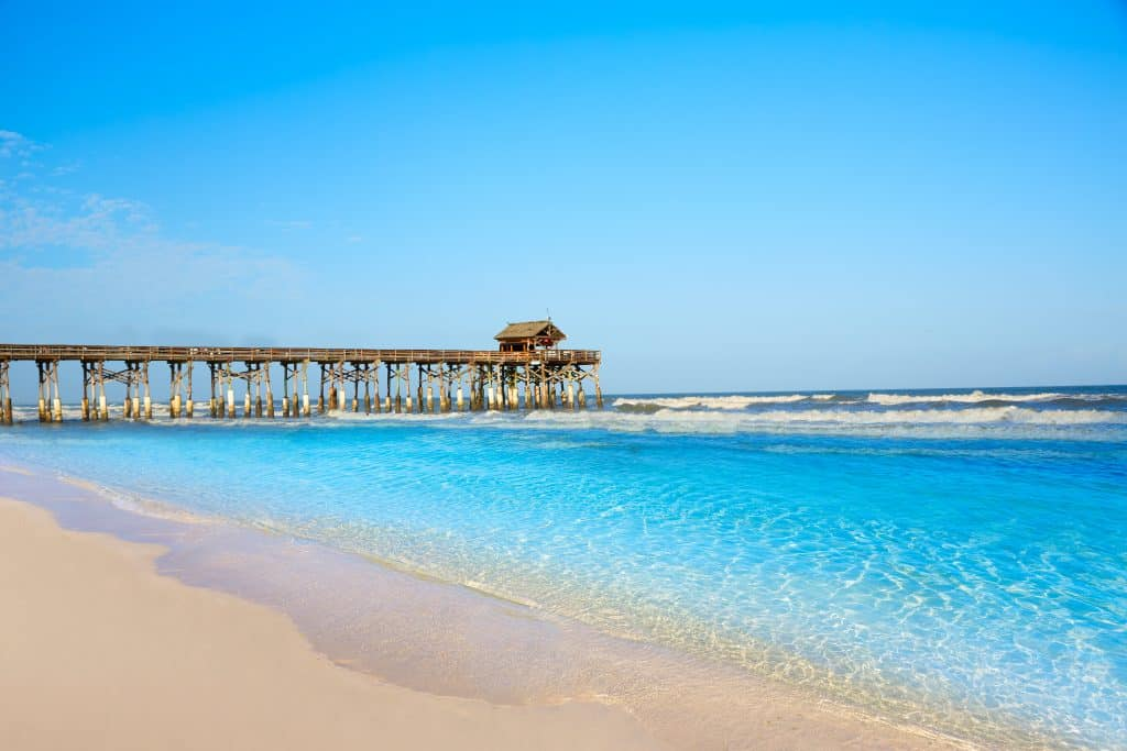 The crystal clear blue waters lap at the shores of Cocoa Beach.