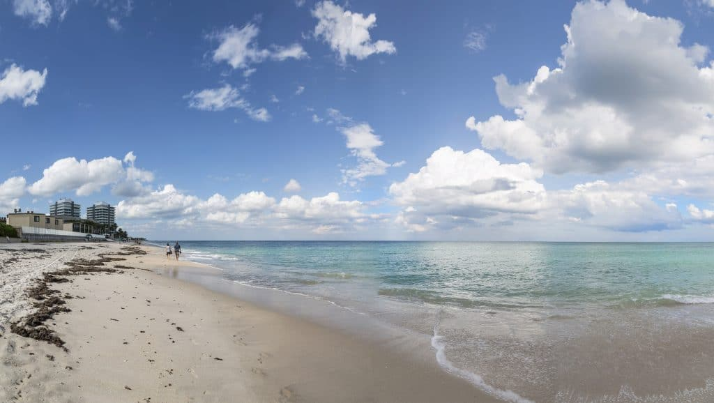 Clouds drift over the crystalline waters of Vero Beach, one of the best family beaches in Florida.