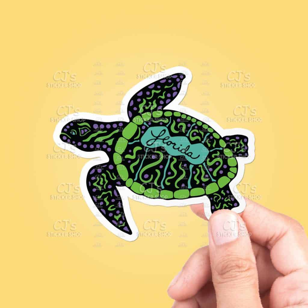 Photo of a black and green sea turtle sticker, one of the best Florida gifts and souvenirs.