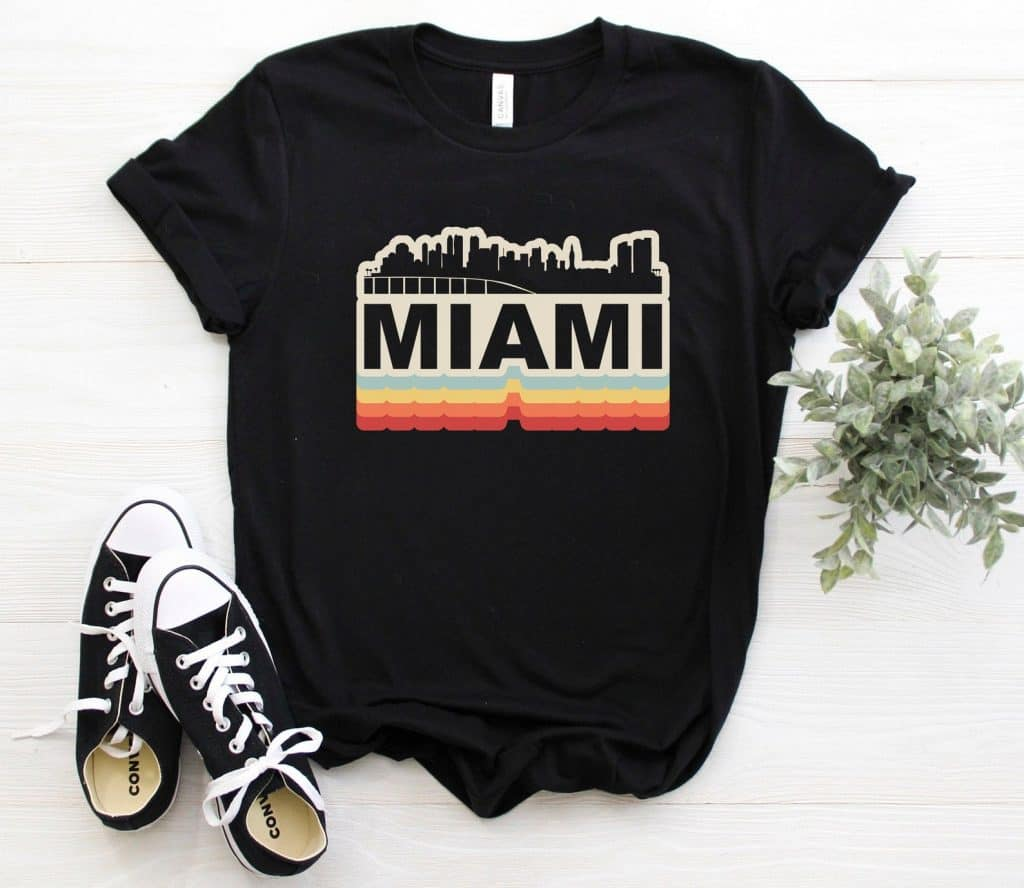 Photo of a black t-shirt featuring a retro Miami design, one of the best Miami souvenirs.