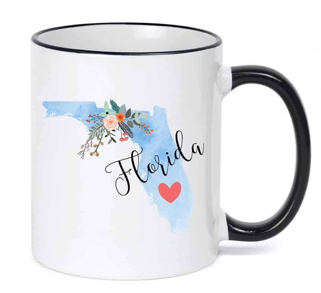 Photo of a white mug with blue ombre Florida decal, one of the best Florida gifts and souvenirs.