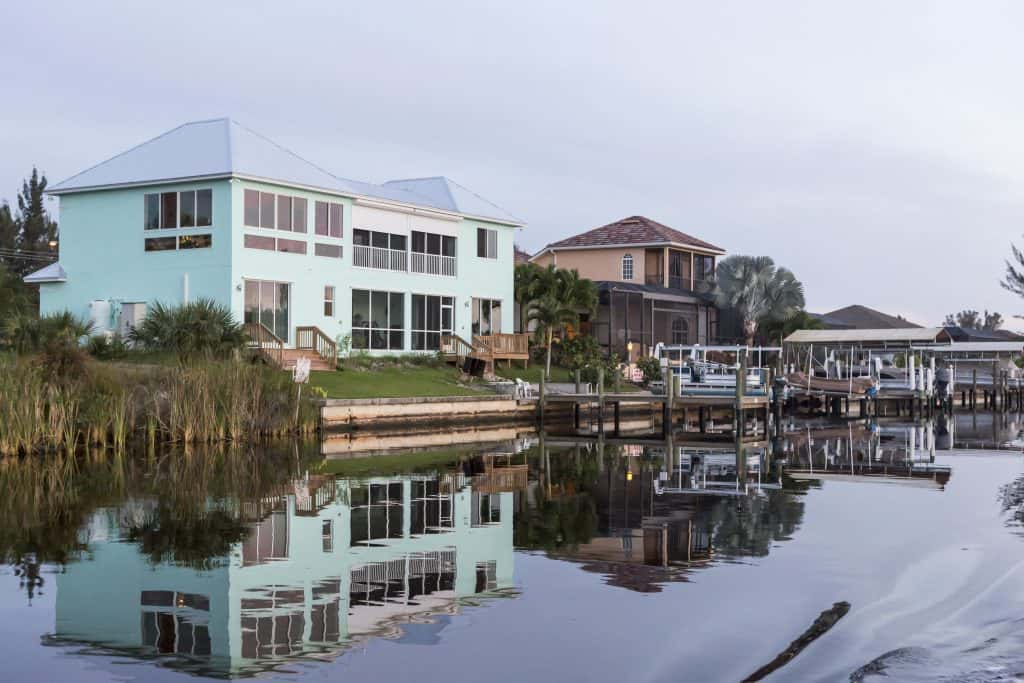 A peaceful canal flanked by the colorful homes of Cape Coral.