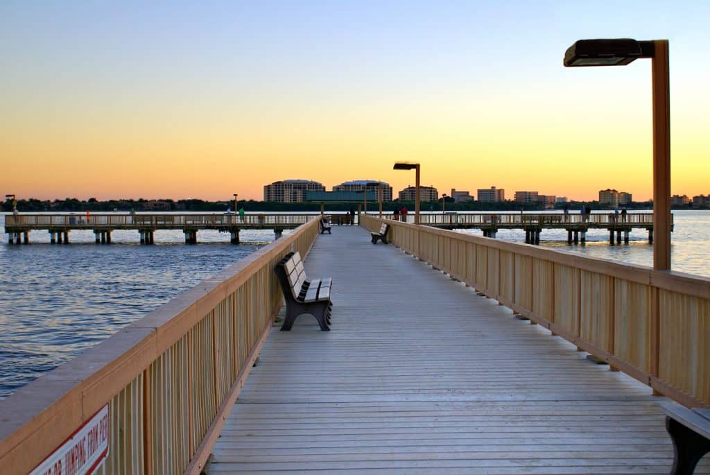 The fishing pier at the Yacht Club Community Park at sunset, one of the best things to do in Cape Coral.