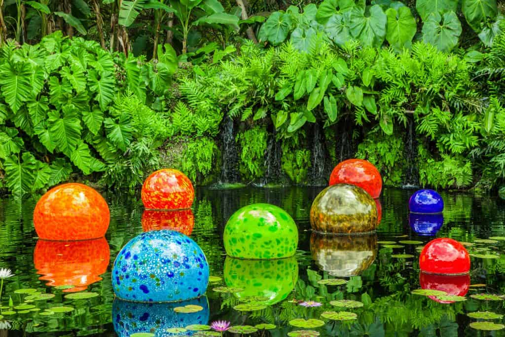 Glass orbs sit in a lily pond at the Fairchild Tropical Botanic Garden, one of the best things to do in Miami.