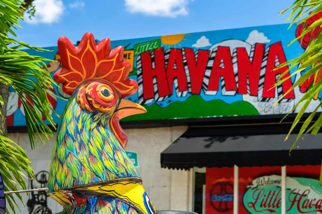 A bright mural and painted chicken sits in Little Havana in Miami, Florida.