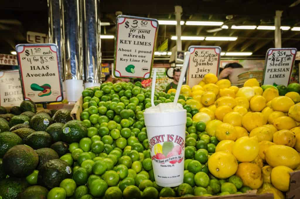 Avocados, limes, and lemons sit with a key lime milkshake at Robert Is Here, one of the best things to do in Miami.