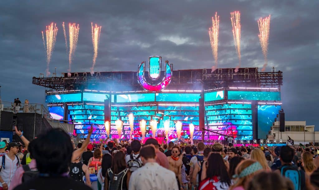 A crowd enjoys the pyrotechnics onstage at Ultra Music Festival, one of the best things to do in Miami.