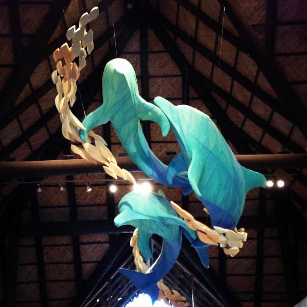 A large dolphin sculpture hangs overhead in the lobby of Discovery Cove, one of the best things to do in Orlando.