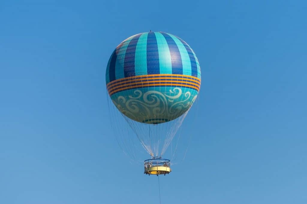 A hot air balloon soars over the Florida landscape, one of the best things to do in Orlando.