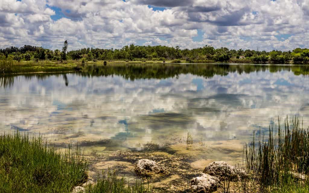 The clear water reflects back a cloud-filled sky at the Everglades nati