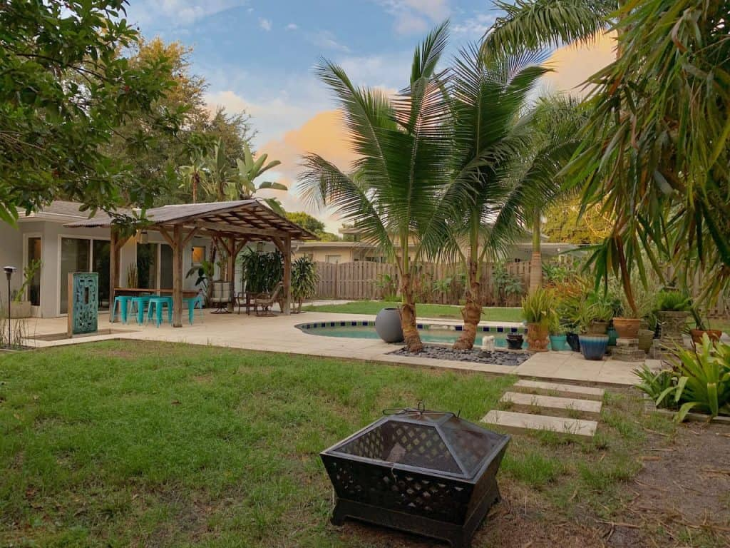 Photo of the lush backyard with swimming pool at an Airbnb in Sarasota.